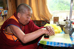 H.H. Dharma King Jigme Dorje stamps his seal onto his congratulatory letter to H.H. Dorje Chang Buddha III that he had already signed